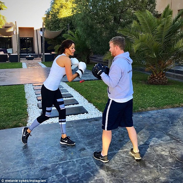 Working up a sweat: Mel was put through her paces by a personal trainer during the bootcamp