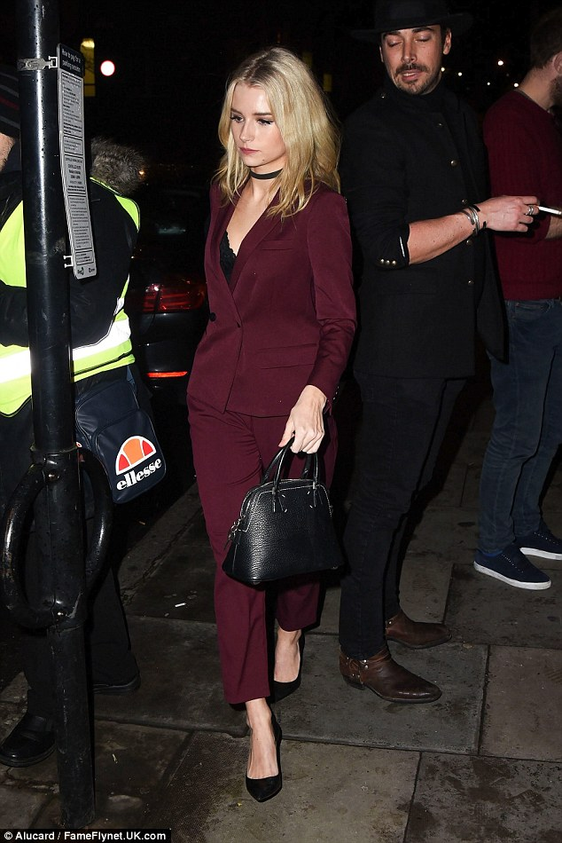 She's got the look: A beautiful leather handbag completed her look perfectly as she channelled office chic