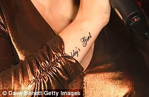 Keeping him close: Sheridan's new inking was the perfect tribute to her beloved father
