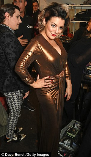 Say cheese: Sheridan beamed as she posed for photos backstage at the Covent Garden launch party