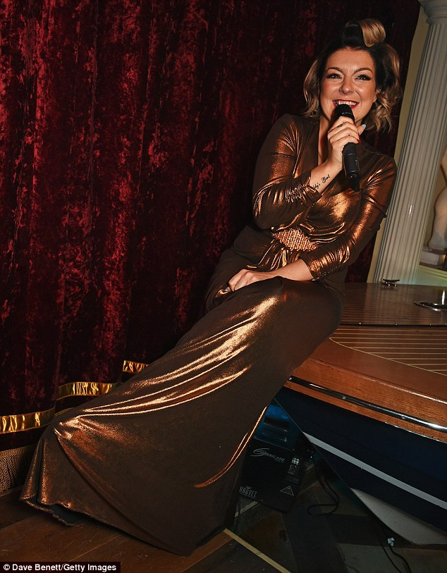 Happy to be here: The star beamed while working her way through two popular West End hits