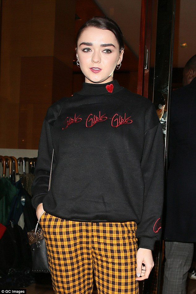 Girl: The 19-year-old actress's sweater featured a high neckline and the words 'Girls Girls Girls'