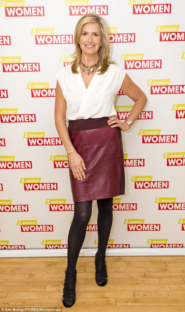 Looking good: She teamed a white sleeveless blouse with a burgundy leather mini skirt