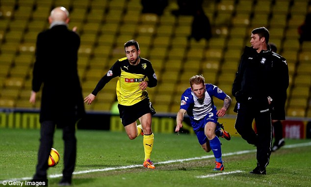 Gaffe: Emyr Huws of Birmingham is tripped by his manager Lee Clark as he chases the ball