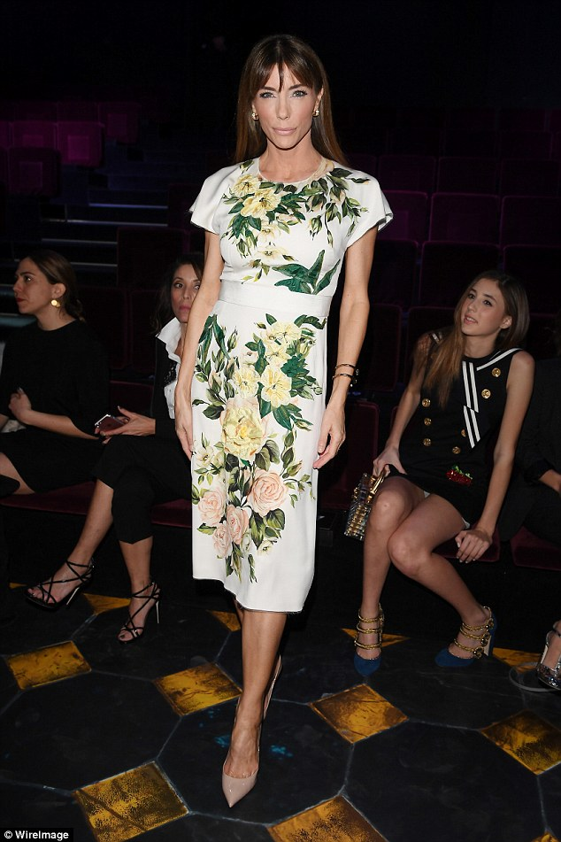 Elegant: She was clad in an elegant white dress featuring a pretty floral pattern, matched with nude stilettos