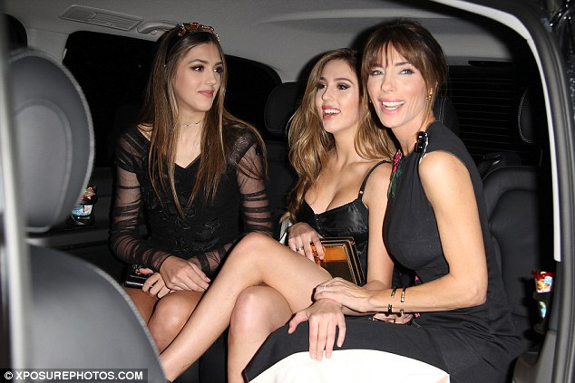 Awe-inspiring: The daughters of movie star Sylvester Stallone - who both walked in the breath-taking show - slipped into dazzling coordinating black looks as they posed for pictures outside the exclusive bash