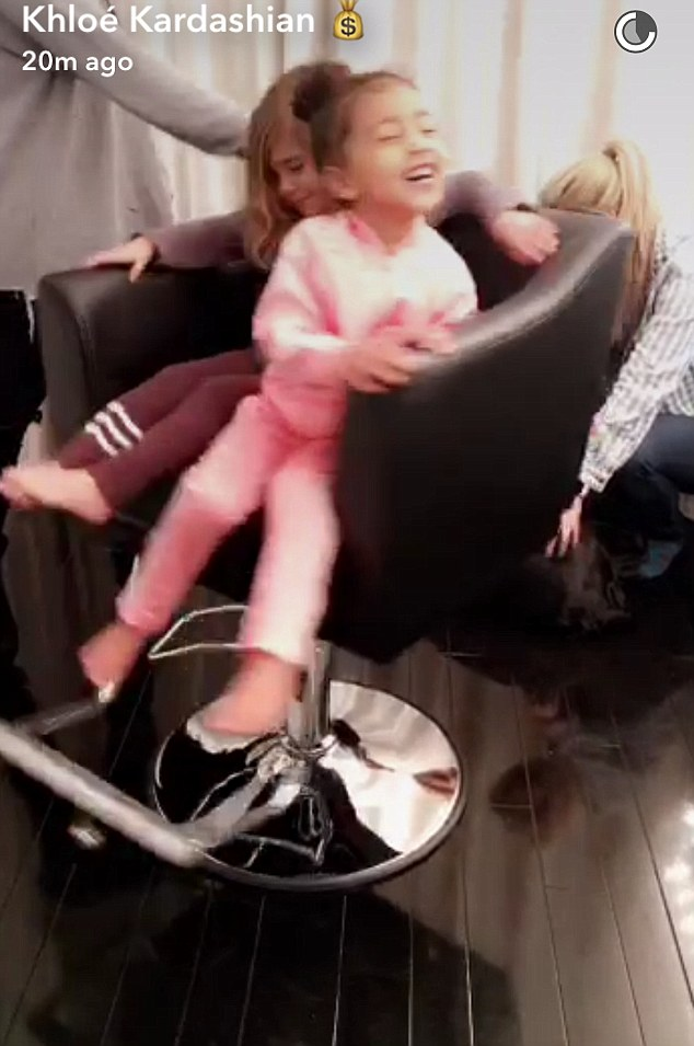 Having a blast: On Thursday, Khloe shared a Snapchat story as she played with her two nieces in her Glam Room at her house