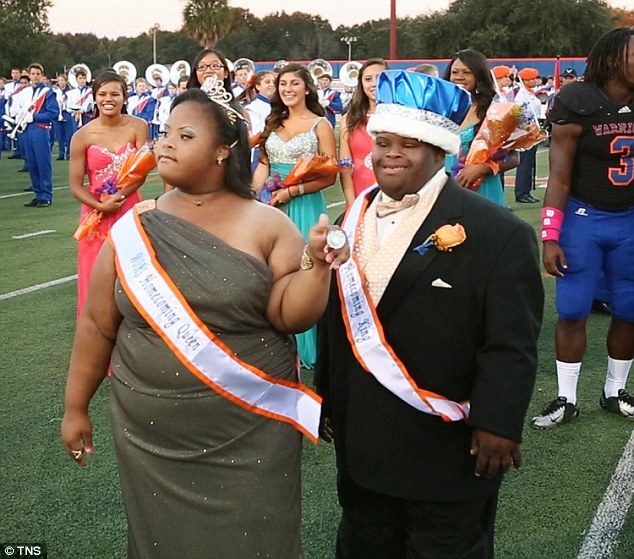 Travjuan 'Bubba' Hunter was crowned homecoming king at Florida's West Orange High School in October 2013. Above, the student is pictured alongside his queen, Semone Adkins, who also has Down syndrome