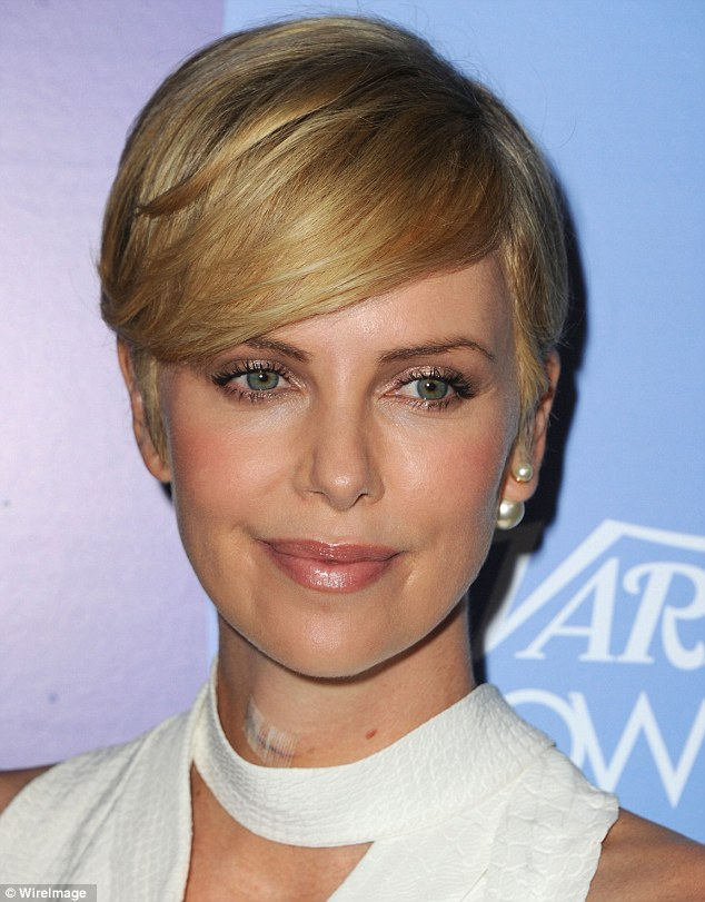 Serious! Charlize Theron steeped out at Variety's 5th Annual Power Of Women Event in Beverly Hills, California, on Friday revealing a cut on her neck after recent surgery to correct a broken vertebra