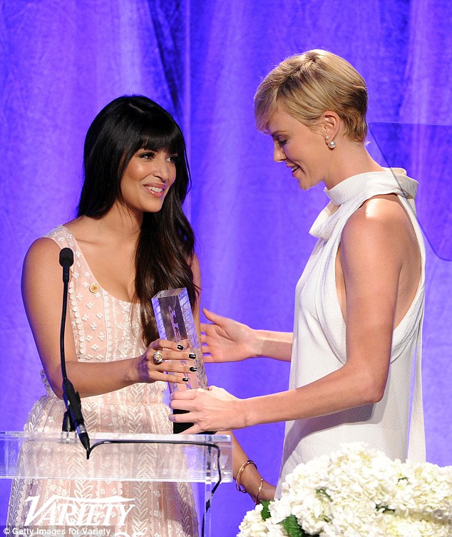 Mixed emotions: Clearly with things on her mind, Charlize reportedly burst into tears on stage as she accepted the award for her philanthropy awards but dedicated it to her mother Gerda