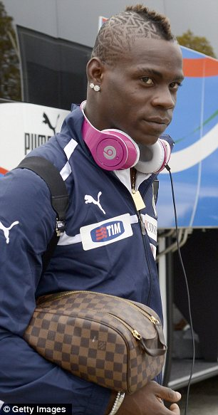 Single man: Mario Balotelli, seen arriving at a training session in Italy on Monday