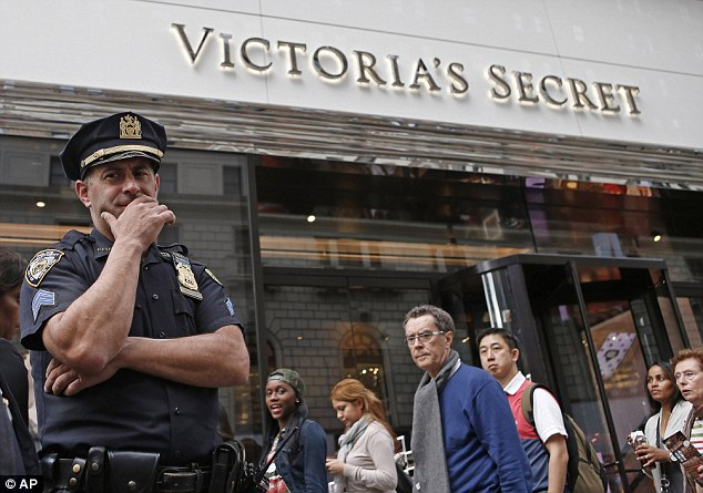 Shocking discovery: A police officer outside the Victoria's Secret branch where a fetus was found in a bag