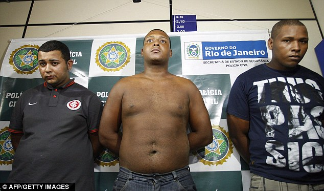 Left to right: Jonathan Froudakis de Souza, Carlos Armando Costa dos Santos and Wallace Aparecido Silva, who allegedly raped a foreign tourist in a minibus in Rio de Janeiro on March 30, 2013