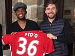 Samuel Eto'o poses with the No 36 shirt with FC Amkar officials on Thursday morning