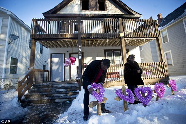 Tragic: Five of Troy Lewis' seven children died in a duplex fire Friday morning
