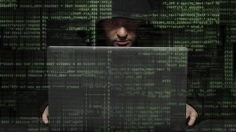 Hacker with binary codes security credit istock KyKyPy3HuK