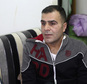 Ammar Sawan, 40, a Syrian refugee from Moadamiyeh, outside Damascus, speaks during an interview in his family's home in Amman, Jordan on Sat. Jan. 28, 2017. Sawan and his family took their first step toward resettlement in the United States three months ago, submitting to an initial round of security screenings. His dreams of a better life were crushed when President Donald Trump issued an indefinite ban on displaced Syrians entering the United States. (AP Photo/Sam McNeil)