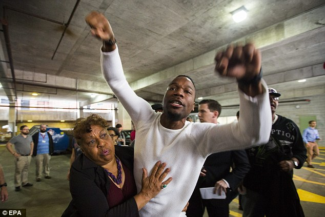 Westley screams at people leaving the Baltimore courthouse following the judge's decision