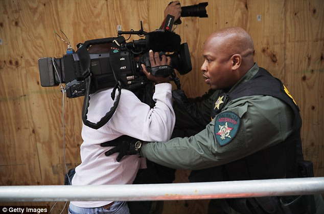 Baltimore City Sheriff's Deputies push photographers back as Baltimore Police Officer Edward Nero's family members leave the Mitchell Courthouse-West