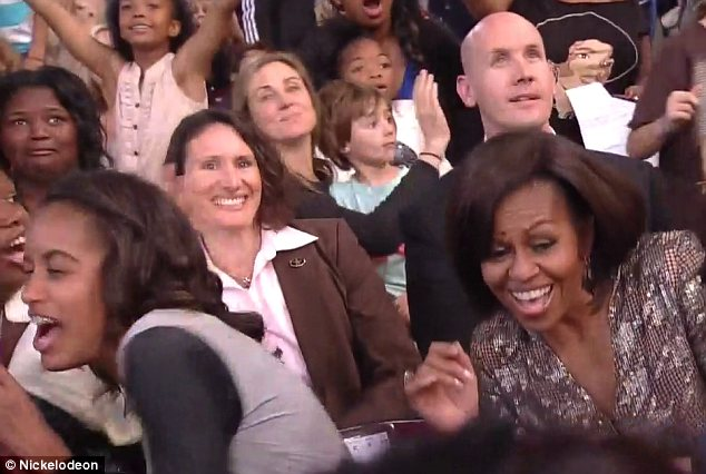 Watch out: Michelle Obama gets in trouble as green slime splashes from the stage at the Kids' Choice Awards