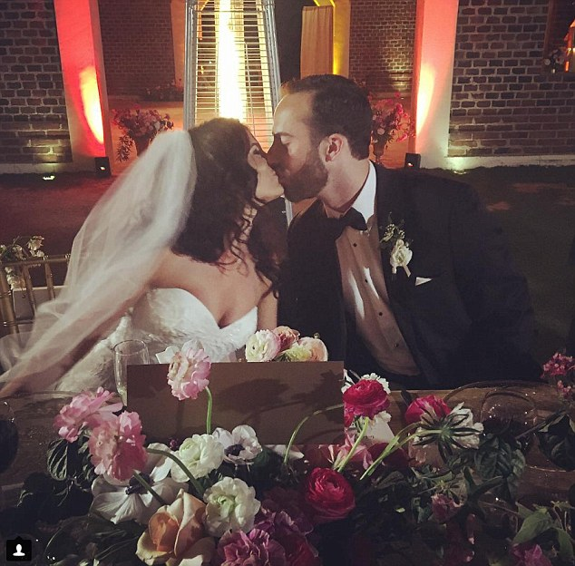 A kiss: The married couple smooching during the reception