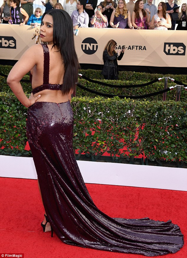 So much skin: Jessica's back was on display too as she showed off the train of her dress