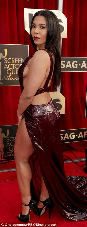 Daring look: Jessica flashed major leg and side-boob in the garment which featured a plunging neckline and thigh-high slit