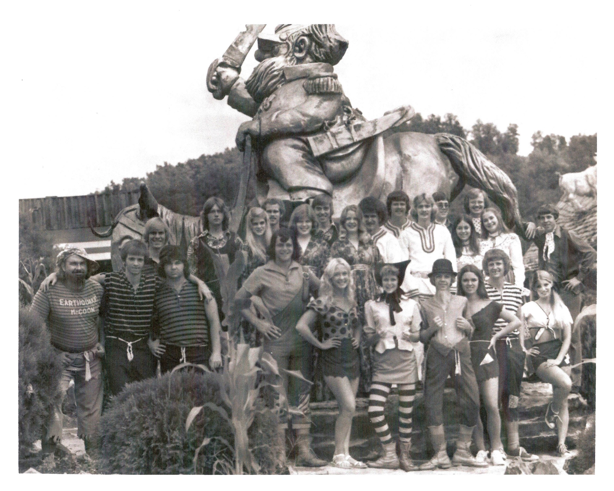 The park's performers and actors, in front of the Jubilation T. Cornpone statue, 1975