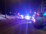 Police officers and multiple ambulances arrive on the scene of a shooting insideQuebec City Islamic Cultural Center