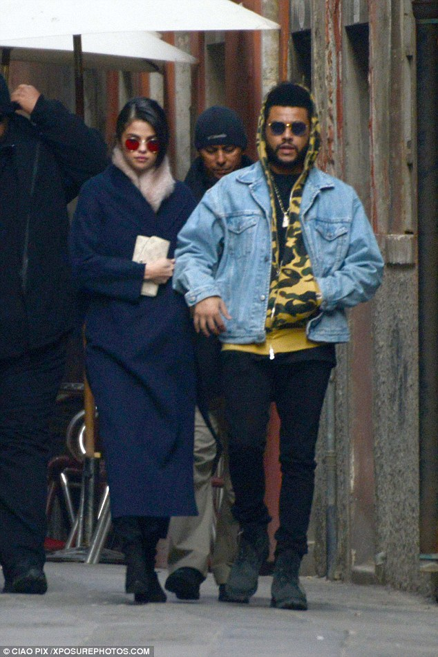 Chilly: Gomez looked cute in a long blue coat with a thick beige scarf. She locked her arm in her beau's