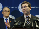Washington Attorney General Bob Ferguson, right, talks to reporters as Gov. Jay Inslee, left, looks on, Monday, Jan. 30, 2017, in Seattle. Ferguson announced that he is suing President Donald Trump over an executive order that suspended immigration from seven countries with majority-Muslim populations and sparked nationwide protests. (AP Photo/Ted S. Warren)