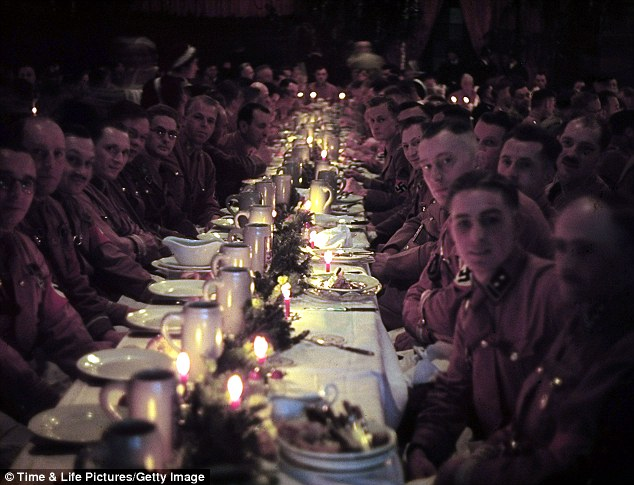 Spoils of war: Officers and cadets begin their dinner