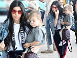 , Liberia,  - - 01/30/2017 - Kim Kardashian holds both her children North and Saint on either hip while sister Kylie carries Tyga's son King, as the whole clan arrives to the airport for their flight out of Costa Rica.\n-PICTURED: Kourtney Kardashian, Reign Disick\n-PHOTO by: INSTARimages.com\n-Instar_Kardashian_West_in_Costa_Rica_10011166529\nEditorial Rights Managed Image - Please contact www.INSTARimages.com for licensing fee and rights: North America Inquiries: email sales@instarimages.com or call 212.414.0207 - UK Inquiries: email ben@instarimages.com or call + 7715 698 715 - Australia Inquiries: email sarah@instarimages.com.au ¿or call +02 9660 0500 ñ for any other Country, please email sales@instarimages.com. ¿Image or video may not be published in any way that is or might be deemed defamatory, libelous, pornographic, or obscene / Please consult our sales department for any clarification or question you may have - http://www.INSTARimages.com reserves the right to pursue unauthor