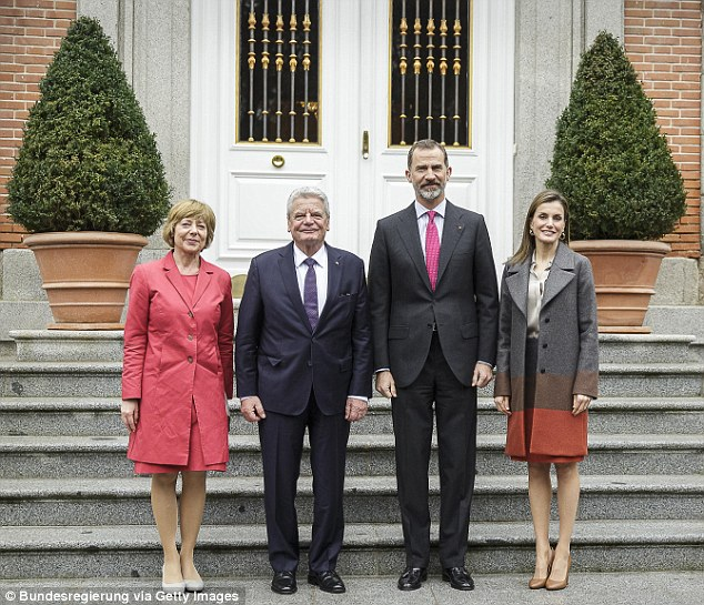 Dignified: Queen Letizia, far right, and King Felipe, second from right, welcomed Daniela Schadt and Joachim Gauck on the steps of the Palace of Zarzuela in Madrid, Spain