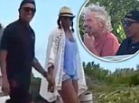 Happy: During day eight of their tropical vacation, the Obamas (above) were carefree and upbeat as they enjoyed the day with their billionaire friend and host Richard Branson in the British Virgin Islands