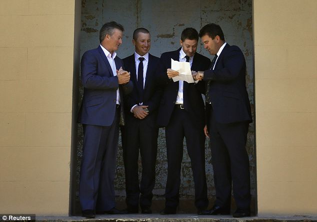 Are you sure? Clarke shows the squad list to former captains Mark Taylor (right) and Steve Waugh (left)