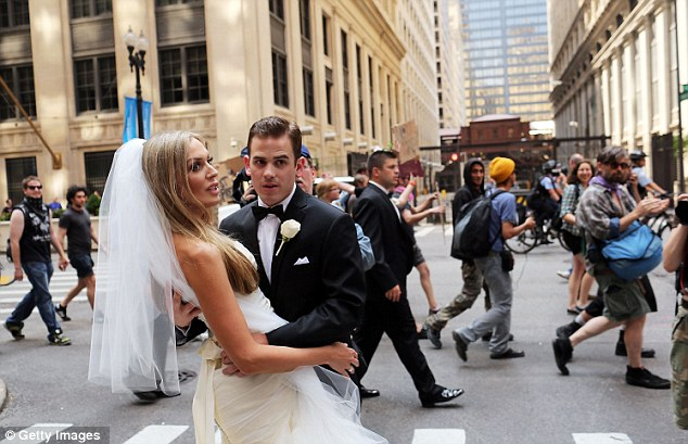 Newly married couple Tim and Beth Alberts look shocked to be caught-up in protests in downtown Chicago