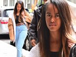 Malia Obama wore high-waisted jeans and a crop top as she showed up to work Wednesday morning to intern at the Weinstein Company in New York City