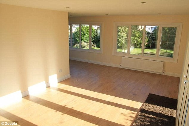 The property has an open plan 'L' shaped living area with windows overlooking the garden