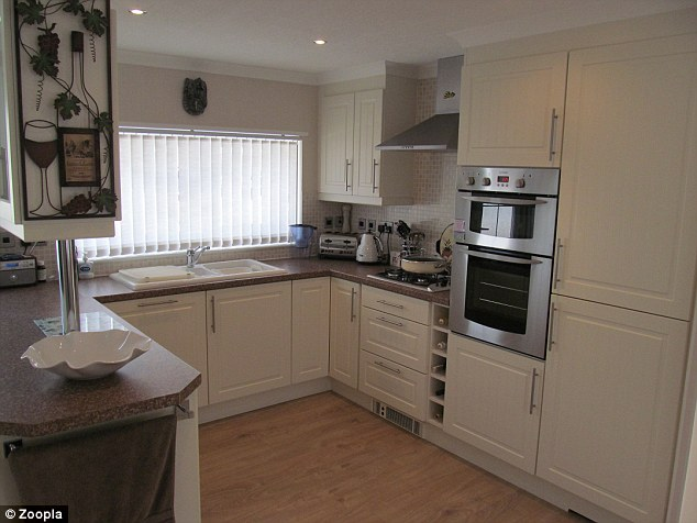 It comes with a modern kitchen with integrated appliances and plenty of work surfaces