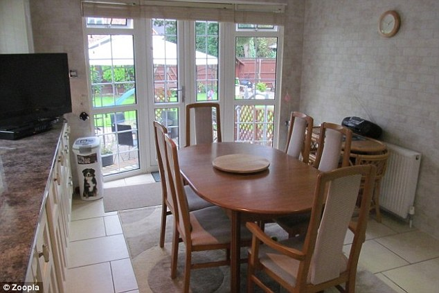 Ideal for family pets: The dining area has patio doors that open onto a large garden