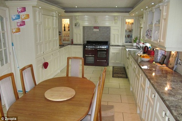 The£499,950 mobile home has a luxury white kitchen that includes a large dining area