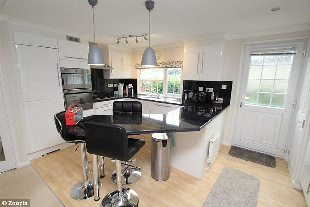 It has a spacious kitchen with a breakfast bar that can comfortably seat three people