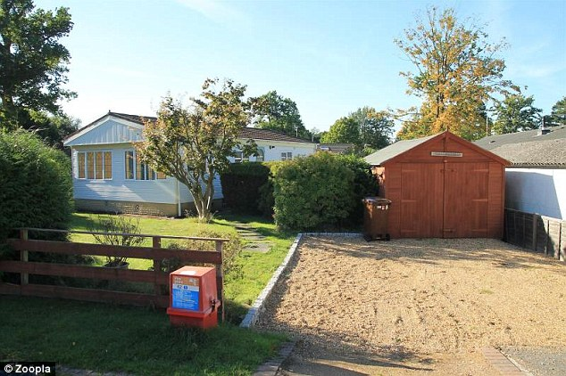 This mobile home in Bracknell has a large garden, a timber garage and space to park two cars