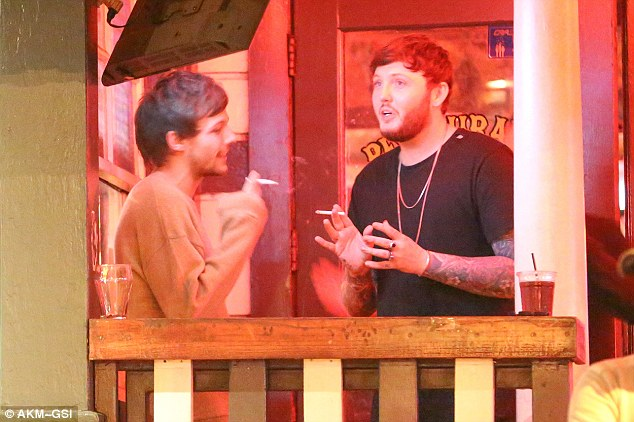 Famous friends: The One Direction star cut a casual figure as he watched his fellow X Factor alumni's concert before heading to Barney's Beanery Gastropub