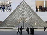 A grainy picture claims to show the immediate aftermath of this morning's shooting, after a machete-wielding man attacked four soldiers outside the Louvre in the centre of Paris