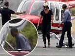 The Obamas arrived at the airport in Tortola on a red helicopter