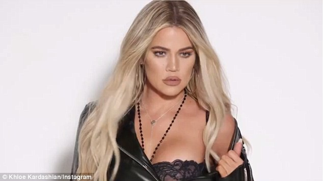 No jeans here: Khloe Kardashian showed off her black lace bra in a promo clip for Good American jeans on Friday