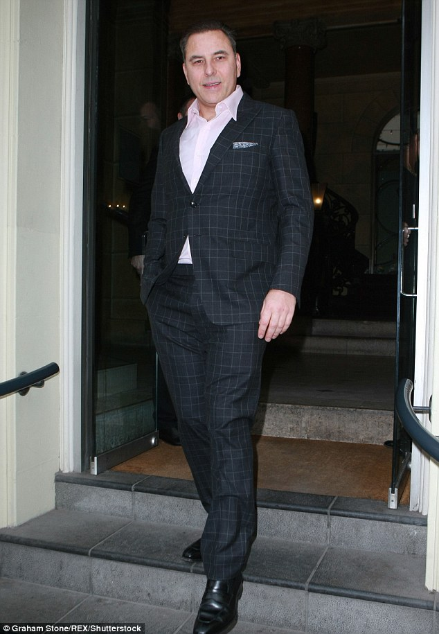 Checkmate! David put on a smart appearance teaming a navy suit with a pale pink shirt