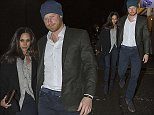 Prince Harry and Meghan Markle were photographed holding each other's hand as they left a trendy club in London
